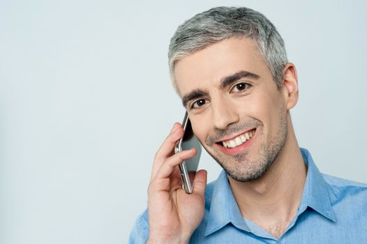 Casual smiling calling on the phone