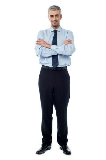 Executive standing isolated over white