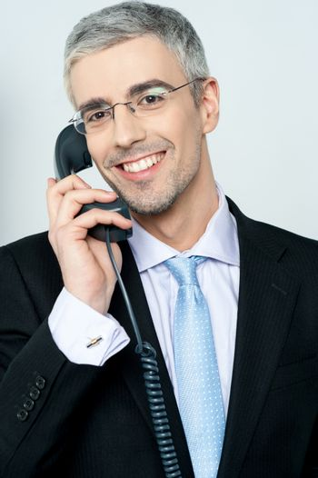 Businessman answering a call