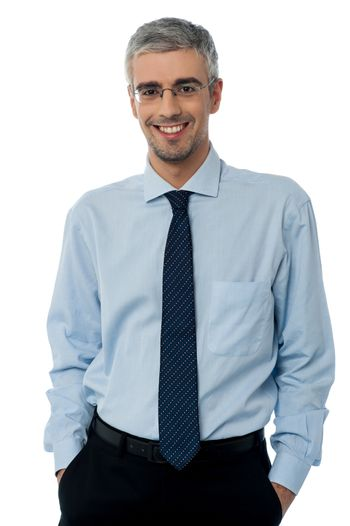 Relaxed young smiling business man