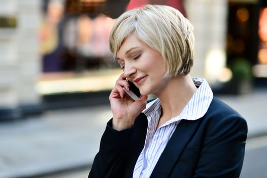 Corporate lady using her phone
