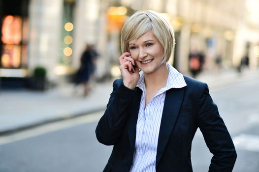Middle aged businesswoman on cellphone