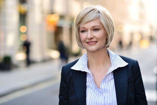 Businesswoman standing in street