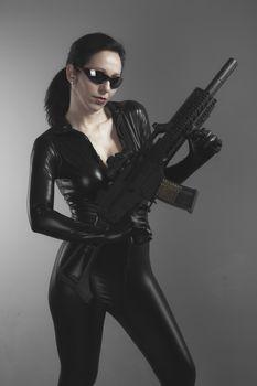 Machinegun, Brunette woman with enormous bulletproof vest and gun