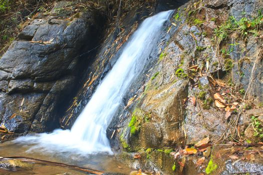 Nature waterfall in deep forest, in national park Thailand