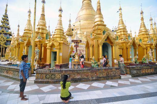YANGON, MYANMAR - October 11: Unidentified pilgrims on the trail around golden Shwedagon Pagoda during Shwesettaw Festival on October 11, 2013 in Yangon, Myanmar