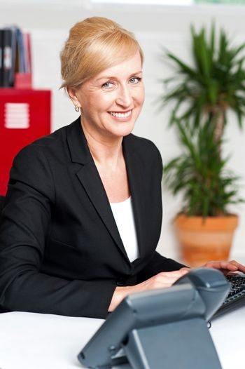 Smiling corporate woman in office
