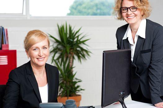 Executive women posing at office
