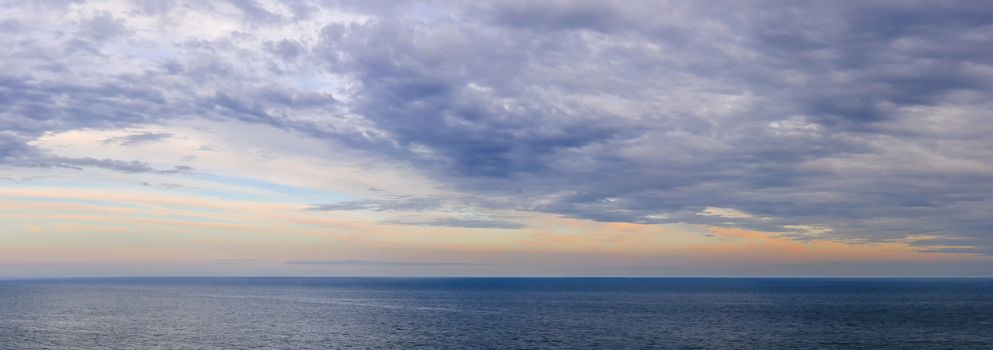 Panoramic view of dramatic sunset sky over vast ocean