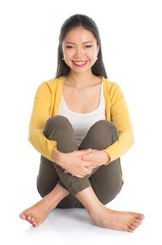 Asian woman full body seated