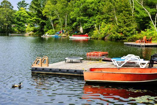 Cottage lake with diving platform and docks