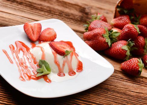 Italian dessert panna cotta with fresh strawberries
