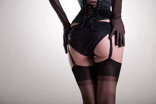 Close-up shot of sexy female buttocks in vintage lingerie