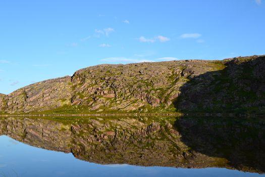 Lake and hill reflection
