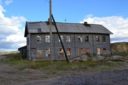 Old house in tundra Murmansk region