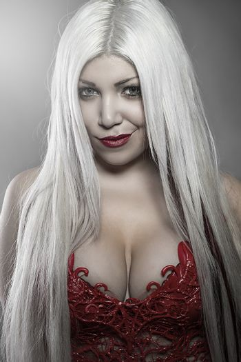 Beautiful woman with white hair red corset scales