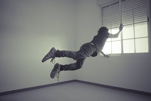 man flying into a window, concept of freedom and imagination