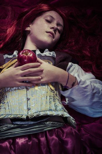 Fairytale, Teen with a red apple lying, tale scene