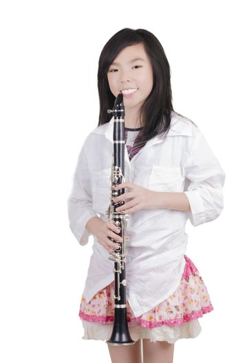 Beauty girl blowing instrument