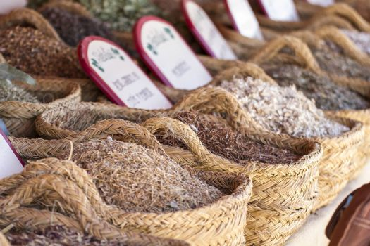 Herbal, wicker baskets stuffed medicinal healing herbs
