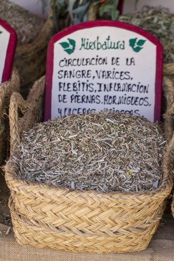 Dried, wicker baskets stuffed medicinal healing herbs