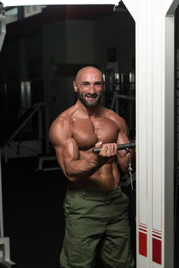 Mature Bodybuilder Exercise In The Gym - He Is Performing Two Arm Biceps Push Up