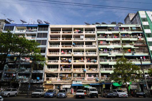 YANGON, MYANMAR - OCTOBER 12, 2013 - Facade of run-down housing block in yangon