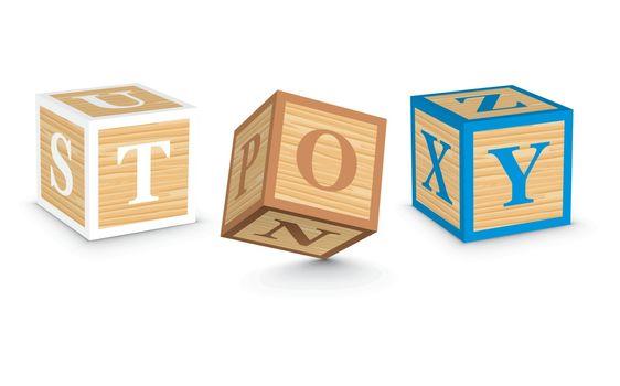 Word TOY written with alphabet blocks