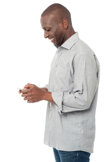 African man using his mobile phone