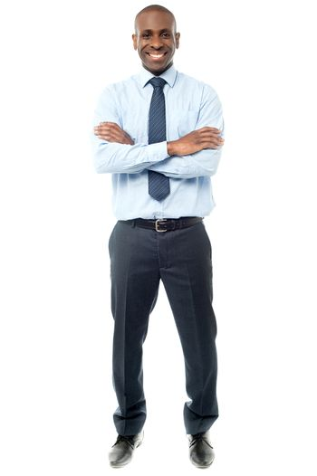 Happy african businessman arms folded