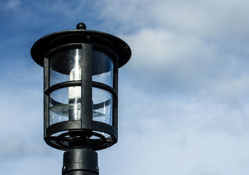 Lamp against the cloudy skies