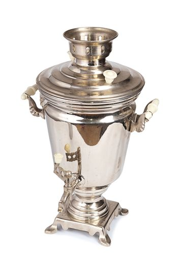 Silver old samovar isolated on white