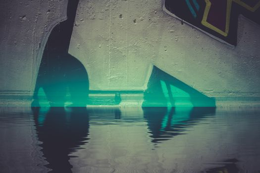 Graffiti reflection in the water, artistic urban arrows
