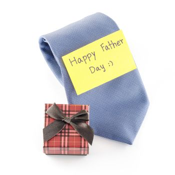 tie and gift box with card tag write happy father day word