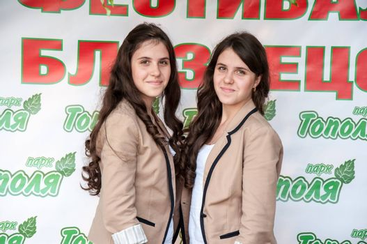 The city of Orenburg, Orenburg oblast, Russia, August 11, 2013. Festival of twins in the City Park of Poplar. http://park-topolya.ru/