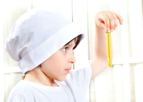 Little boy doing biochemistry
