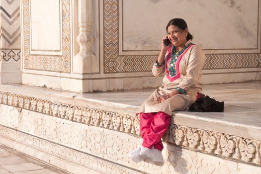 Indian woman chatting happily Taj Mahal