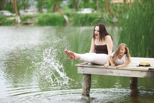 Family resting near pond