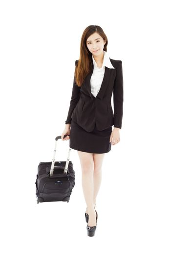 smiling businesswoman walking and carrying the baggage