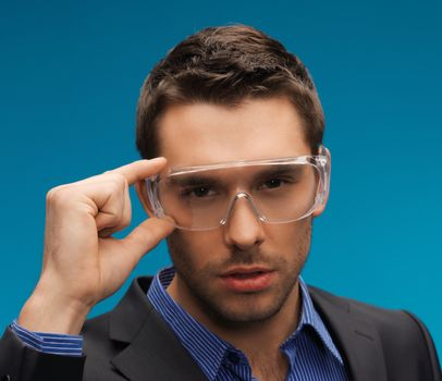 businessman in protective glasses