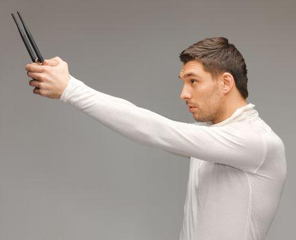 futuristic man with gadget