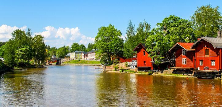Old red warehouses alongside river Porvoo