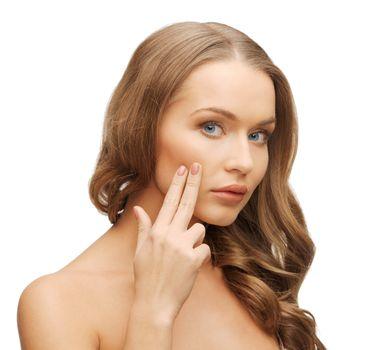 beautiful woman pointing to cheek