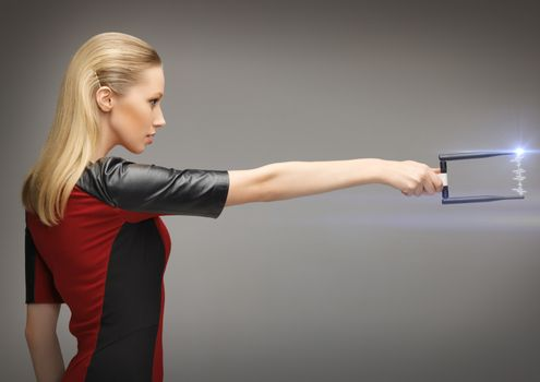 woman with sci fi weapon