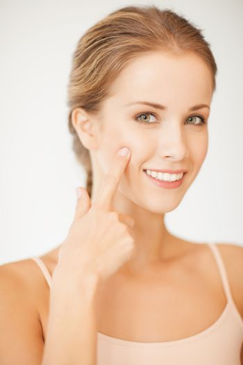 woman pointing at her cheek