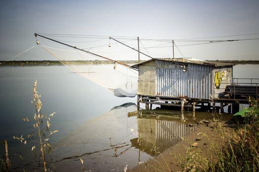 Fishing hut on the Pialassa della Baiona brackish lagoon near Marina Romea along te  Adriatic seaside in Ravenna (Italy)