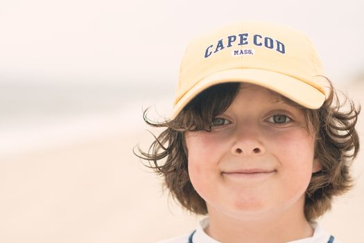 Boy smiling on the beach