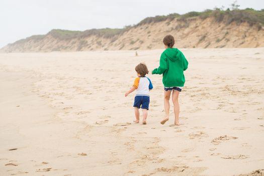 Family walk on the beach