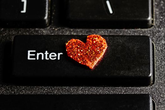 Enter computer keyboard key with red  heart symbol