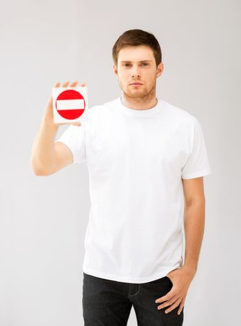 young man showing no entry sign